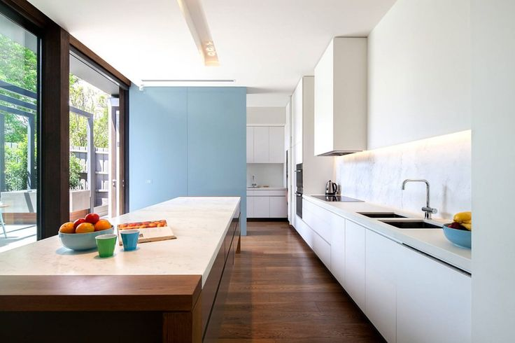 Kew House by Neil Architecture. Space saving partitioning of scullery area