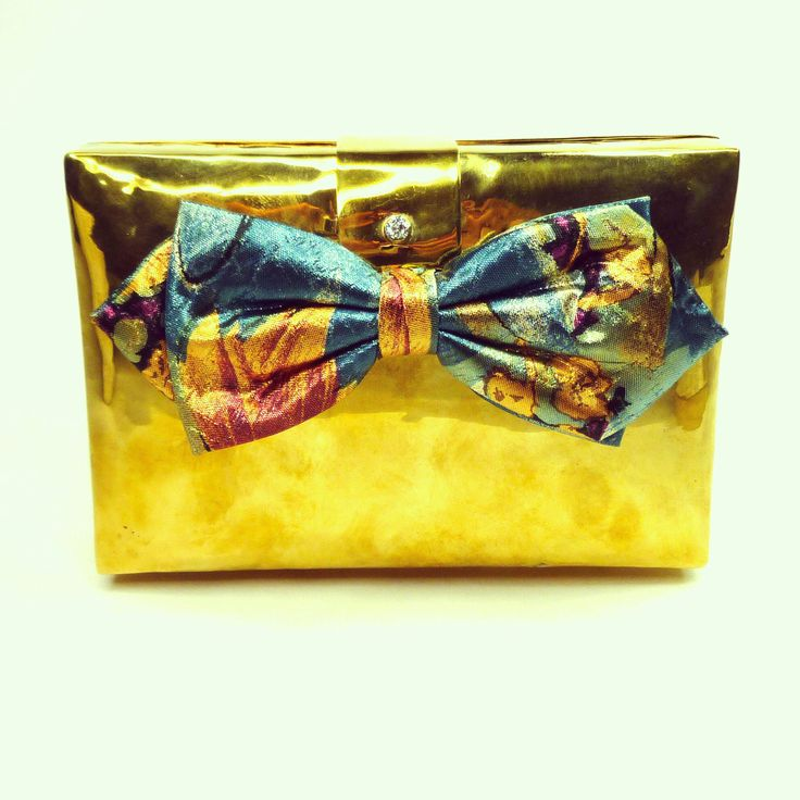 Leya clutch made from a Cambodian bombshell #emiandeve #bullets2beauty