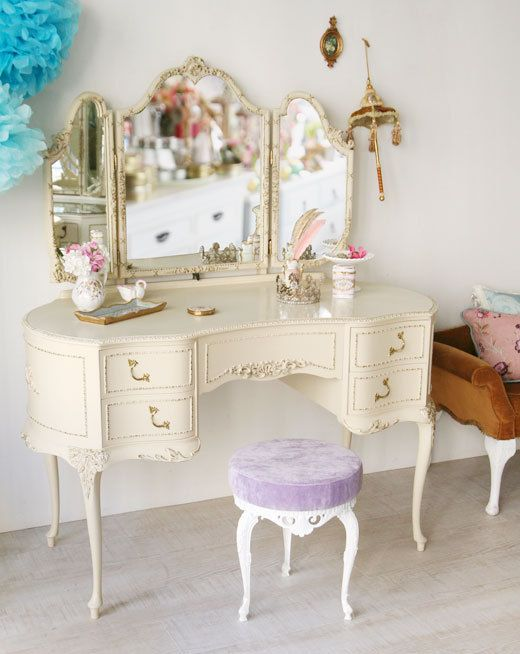 I would love to buy a vintage vanity at the thrift store or something and repaint it and reupholster the seat with a pretty fabric.