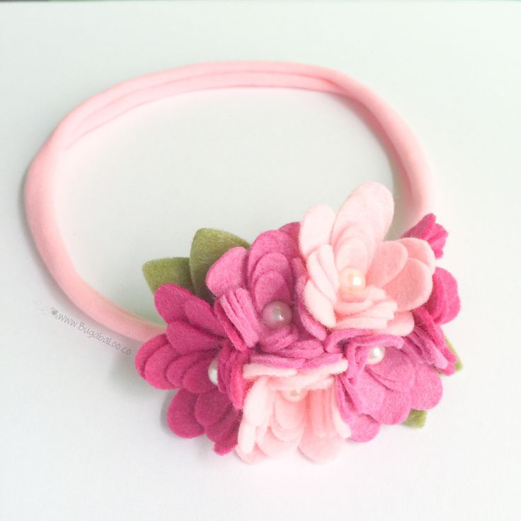 A fun, soft, and feminine pink felt flower headband for you or your little wild and free flower child! This listing is for one pink, magenta, and fuchsia cluster flower band. Each band includes one cl