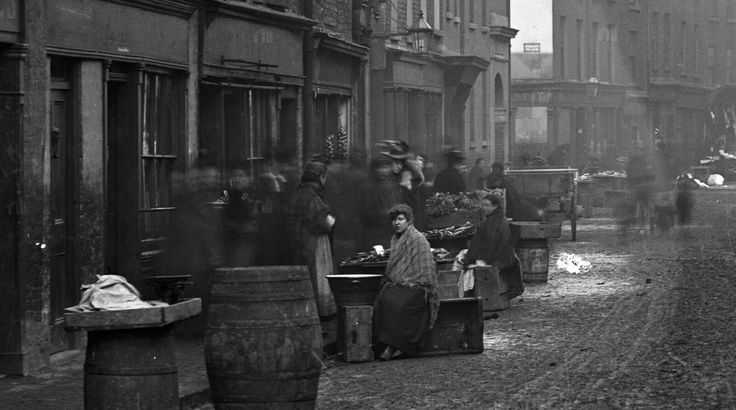 FISH & CLOTHING SELLERS ON PATRICK STREET, DUBLIN (before 1906) A wonderful photograph showing Patrick Street before the slum clearances and the building of the Iveagh Trust buildings. With thanks to CL.