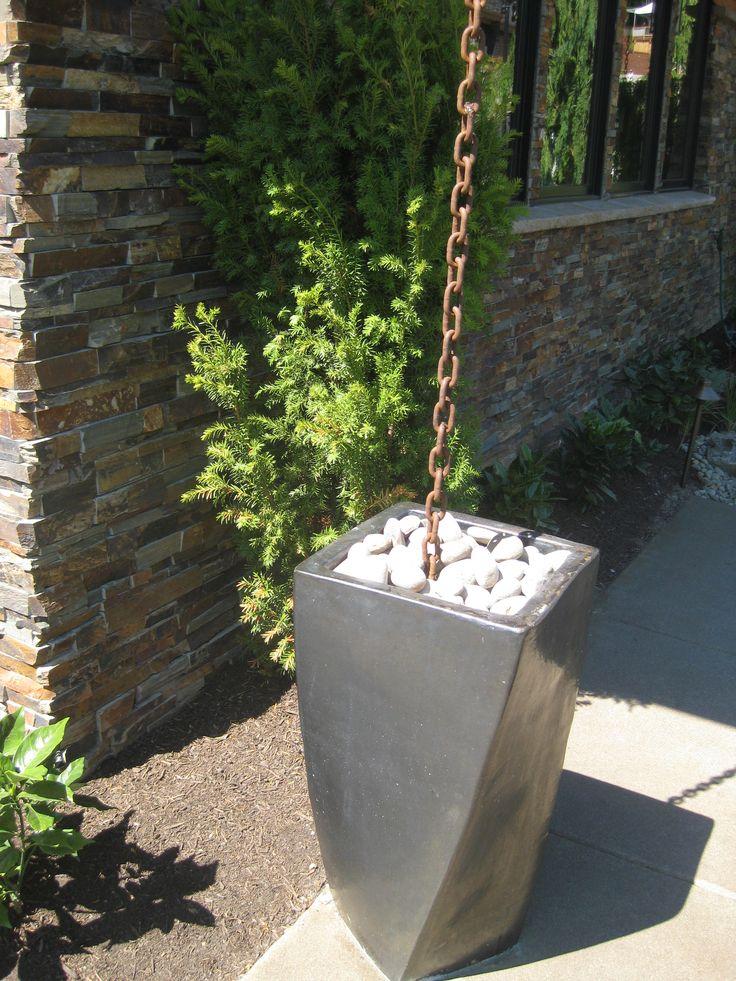 Chain gutter downspout into planter/rain barrel