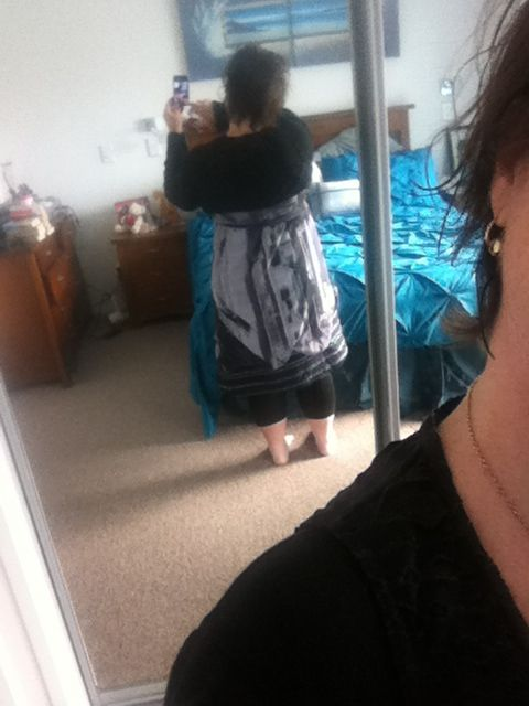 Back view of the fabulous girly homemade dress. Can be worn, strapless with bust, or wait emphasized. It can also be worn as a skirt and as a reversible outfit.