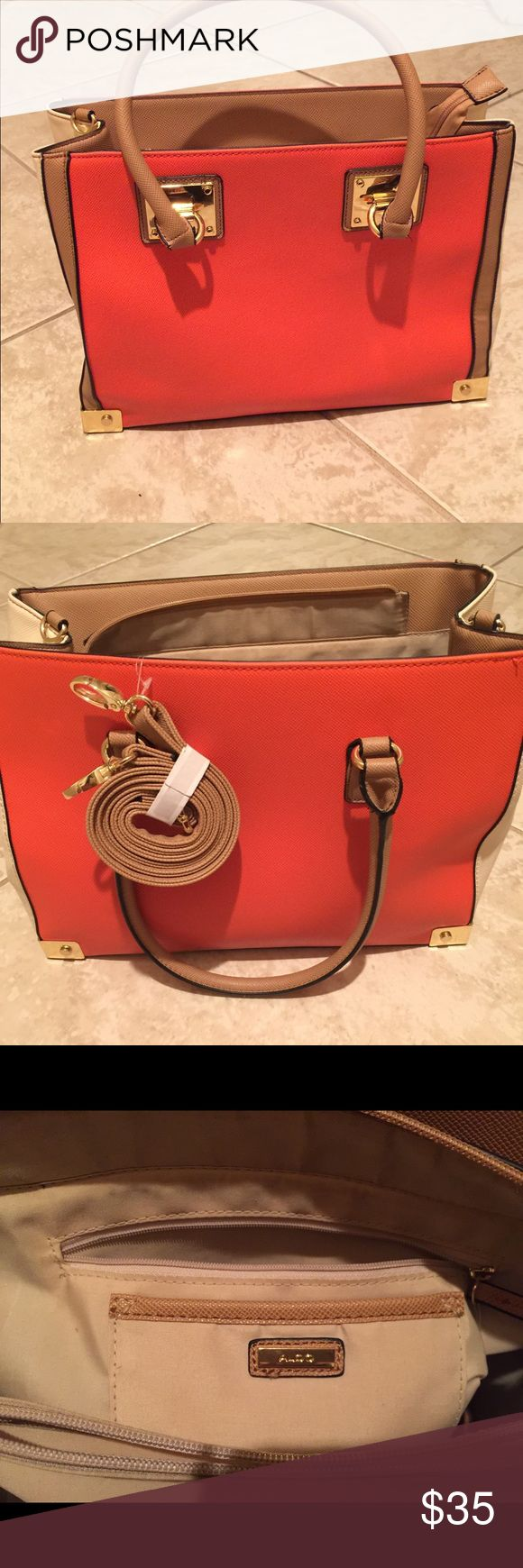 Aldo's Handbag Leather orange and cream Aldo's handbag outlined in gold metal. Includes extended strap. Be prepared to receive endless compliments. Aldo Bags