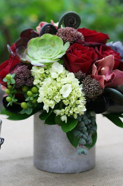 Centerpiece - succulents, red roses, cymbidium orchids, hydrangea, fiddlehead fern curls, green hypericum berries ...
