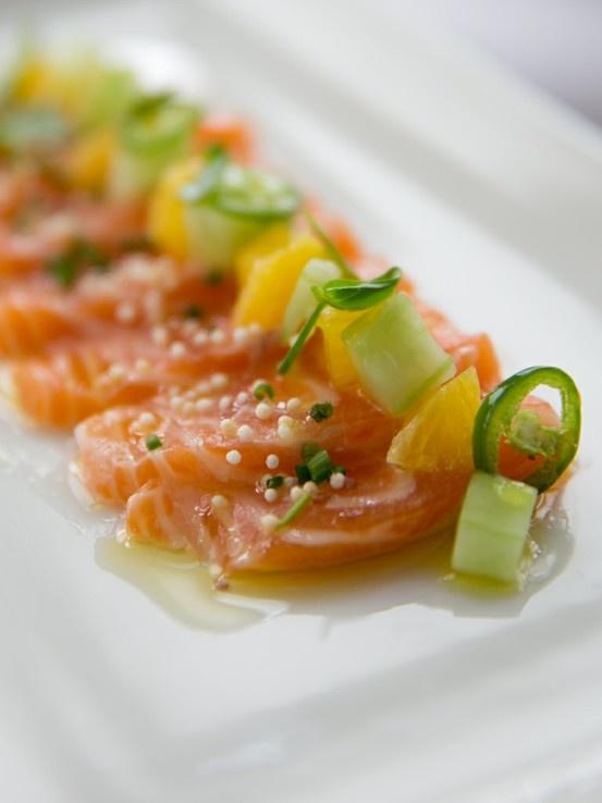 Scottish Salmon Crudo with Orange, Serrano, Micro Basil and Cucumber.