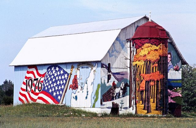 The Bicentennial Barn, Glen Arbor, Michigan.  Since this photo was taken, the barn has changed hands a few times, and the murals have come and gone.  This is posted for memory's sake