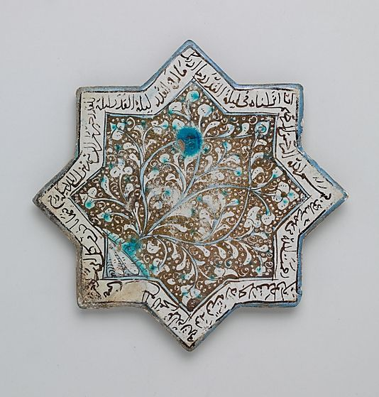 Eight-pointed Star Tile with Foliage and Inscription  Object Name:Star-shaped tile  Date:second half 13th century  Geography:Iran, probably Kashan  Culture:Islamic  Medium:Stonepaste; luster-painted on opaque white glaze under transparent glaze  Dimensions:8 in. (20.3 cm)  Classification:Ceramics-Tiles  Credit Line:H.O. Havemeyer Collection, Gift of Horace Havemeyer, 1941  Accession Number:41.165.28