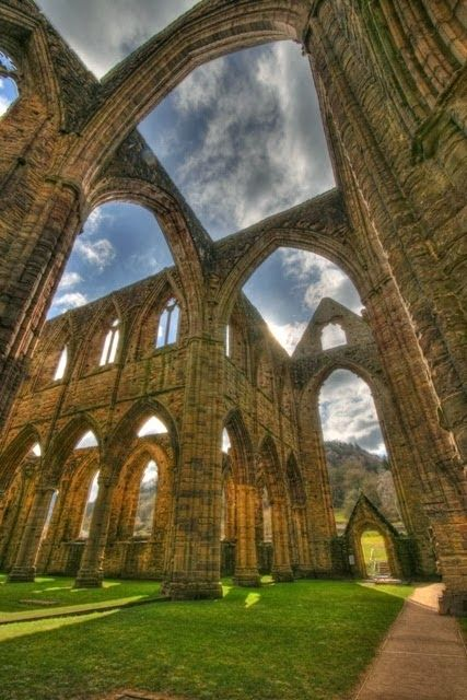 The ruins of Tintern Abbey in South Wales, the result of Henry VIII's dissolution of the monasteries, which brought 400 years of monastic life to an abrupt end in the 1530s.