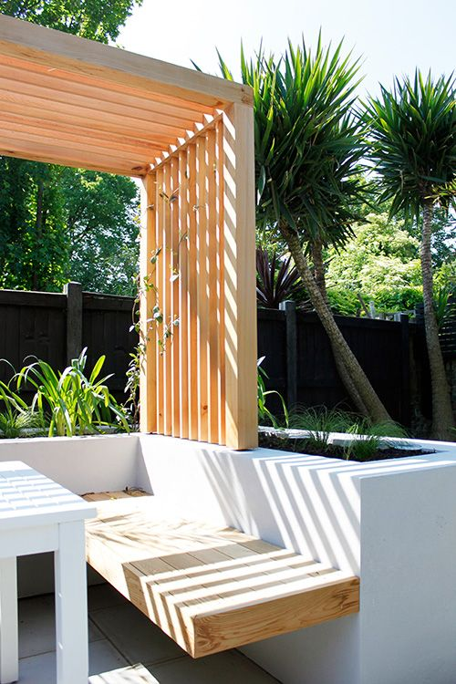 Raised planter with cantilever bench and western red cedar pergola.