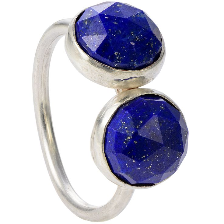 "Two denim blue lapis gemstones adorn this simple but powerful ring. The rose cut stones are a substantial size and have golden flakes that reflect light on their triangular facets. The side-by-side stones look classy, simple and out of the ordinary.  This unique gemstone design doubles the visual impact. The faceted cabochons perfectly wrap around the finger, reinforcing a sense of confidence and aspiration. You can wear the ring with a matching necklace from the ""Two"" collection."