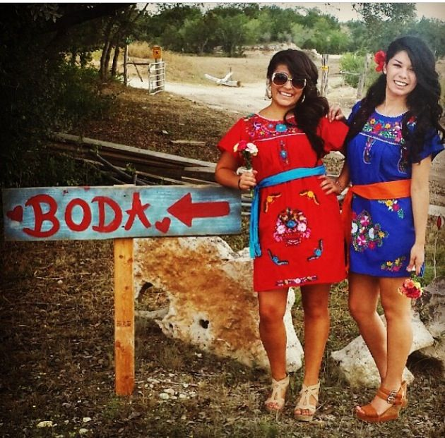 Mexican fiesta themed wedding bridesmaids with the wedding sign to the ranch! Loved my girls!