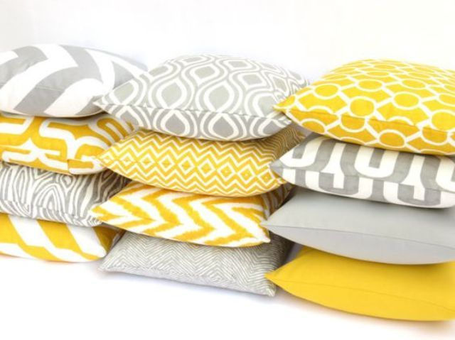 yellow and grey mix and match pillows are  a cheap way to rock these colors