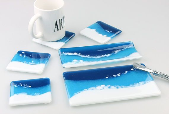 Ocean Waves Fused Glass for the Home. Cheese board, cracker tray and set of coasters remembrance of white sandy beaches and tropical waters by GetGlassy.  #fusedglassart  #hostessgift  #handcrafted  #hudsonvalley  #midhudsonEtsymakers #fusedglass #homedecor #tabletop #cheeseboard #coasters #glasstran #sandybeach #whitesands #oceanwaters