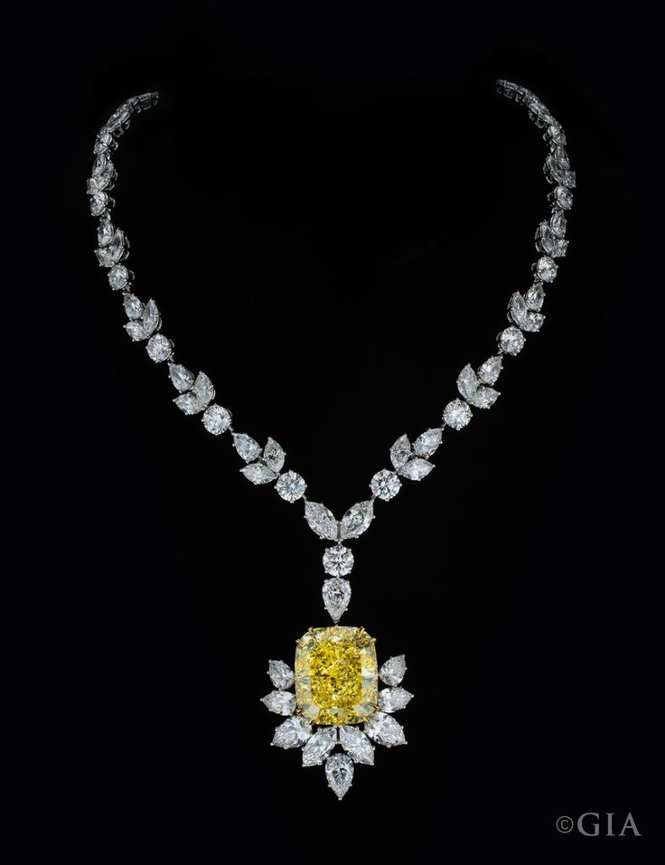 A 54.29 ct. Fancy Intense yellow diamond suspended from a necklace set with 67.10 carats of colorless diamonds.