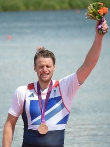 Northern Ireland's Alan Campbell won bronze in the Olympic final of the men's single sculls race.  He is the third rower from Coleraine in County Londonderry to win a medal over the past 24 hours, with the Chambers brothers taking silver on Thursday.  It is the first time a team from Great Britain and Northern Ireland has won a medal in the single sculls since 1928.    Campbell appeared completely spent in his post-race interview and was helped to the medal ceremony by Sir Steve Redgrave.