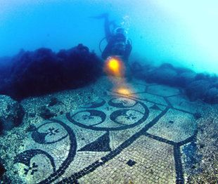 This underwater sight is Parco Archaeologico Sommerso di Baia in Pozzuoli, Italy. It's just 30 minutes west of Naples and submerged five - 30 feet underwater.