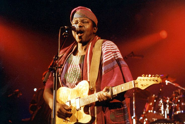 King Sunny Ade is a Legendary musician who plays the genre of music called Juju. He is famous not only for singing and releasing so much albums but also for playing guitar too. And he was also nominated for Grammys in the past.
