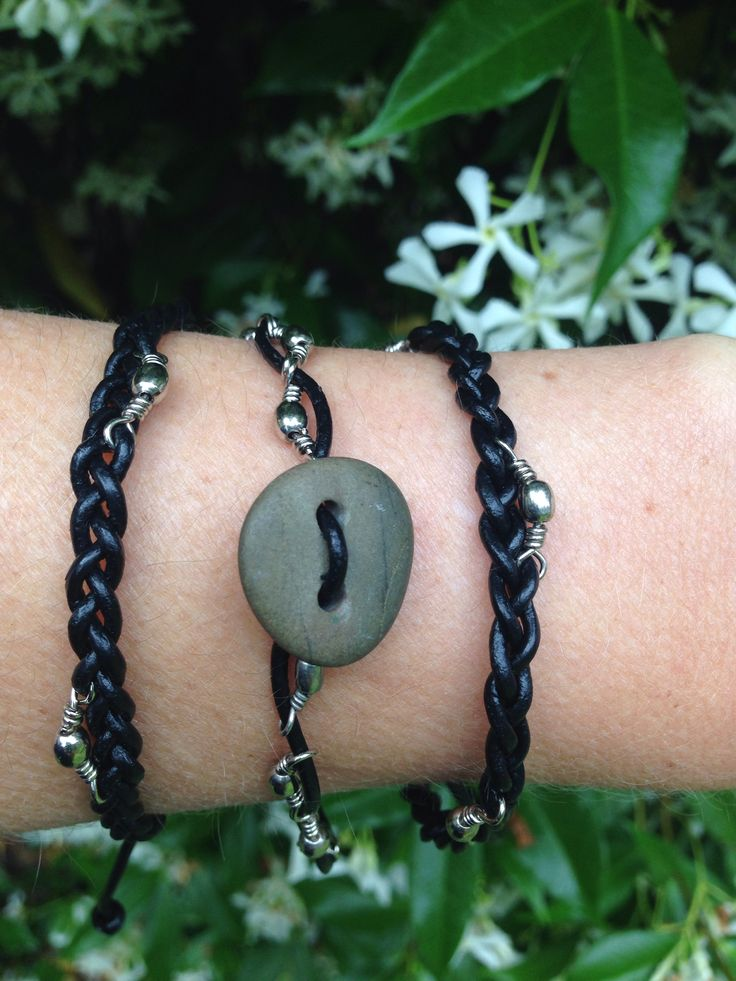 Drilled beach stone, leather and steel bracelets.