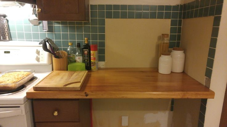 Wood countertop from old barn boards where fridge used to be.