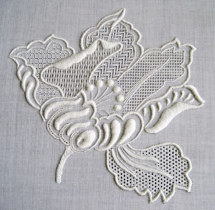 This gorgeous whitework flower is the work of Tatiana Tara. It's a combination of satin stitching and lots of different pulled thread patterns.  Image courtesy of http://stitchinfingers.ning.com/photo/white-flower-macro  Thank you to the great Facebook page Inspirations Magazine for first sharing this work of art.