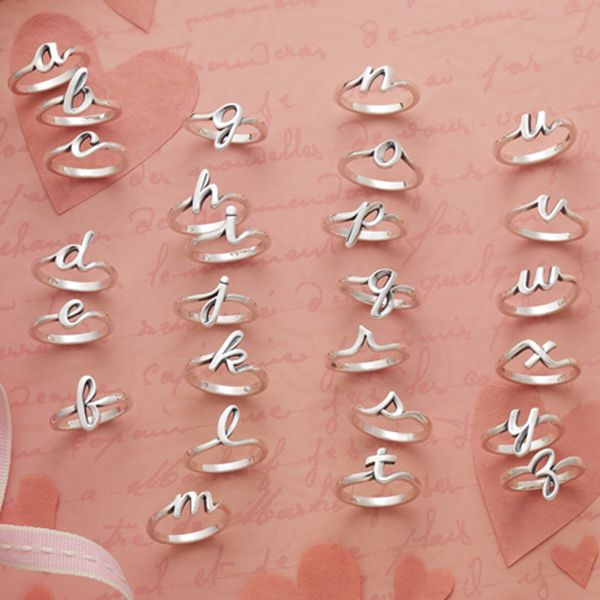 Valentine Collection 2016 - Compose a love letter with our new sterling silver Script Initial Rings. Wear one or stack many! #JamesAvery