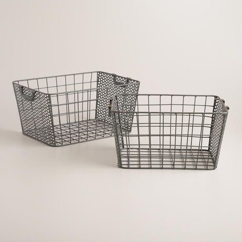 With hinged handles and a distressed zinc finish, these baskets combine wire on two sides and punched metal on the others for striking, vintage-inspired style. >> #WorldMarket Storage and Organization