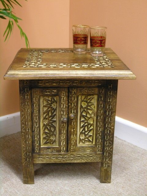 Small wooden cabinet with doors. http://www.maroque.co.uk/showitem.aspx?id=ENT02948&p=01570&n=all