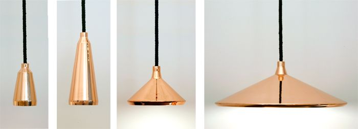 the angular copper shades are suspended by leather rope.