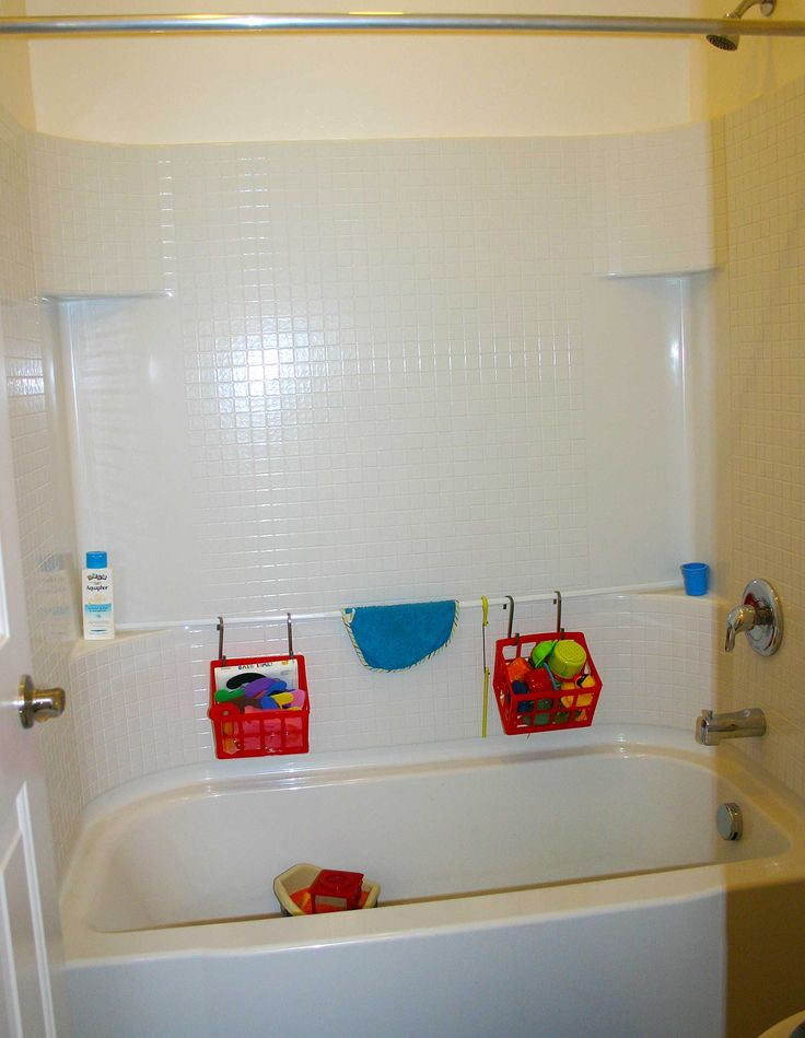 Use A Tension Bar And Some Storage Bins That Drain For Temporary Toy Storage  In The Bathtub