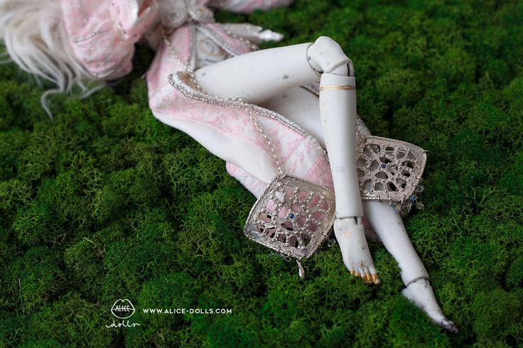 Limoges Porcelain/ Painted with Gold & Platinum Luster/Swarovski crystals / Silver jewelry/ Jewelry contain 10 different Sapphires / Hand embroidered costume / Completely handcrafted. Every do…