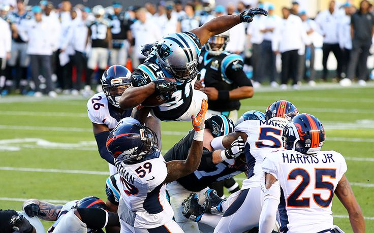 Jonathan Stewart (28) of the Carolina Panthers scores a spectacular touchdown against the Denver Broncos in the second quarter