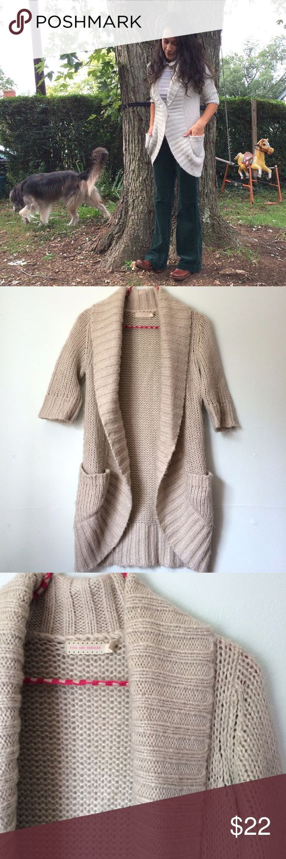 """Urban Outfitters Sweater 3/4 length sleeves and pockets make this a highly functional sweater coat, lightweight and warm. 75% Acrylic, 15% wool, 10% Mohair. Lovely light grey. It's modeled with a large safety pin holding it closed but otherwise has no button or hook closure. 9"""" sleeve, approximately 19"""" armpit to armpit & 32"""" long. By: Pins and needles. Could fit a medium as well due to generous sizing. Would be awesome as a maternity & nursing sweater. Urban Outfitters Sweaters"""
