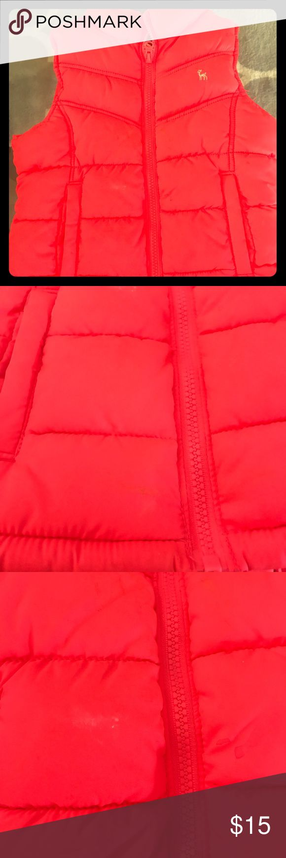 Old Navy puffer vest- neon orange Super cute neon orange puffer vest. Old Navy kids size small. Few little places on it but nothing that can't be washed. No rips or tears. Old Navy Jackets & Coats Vests