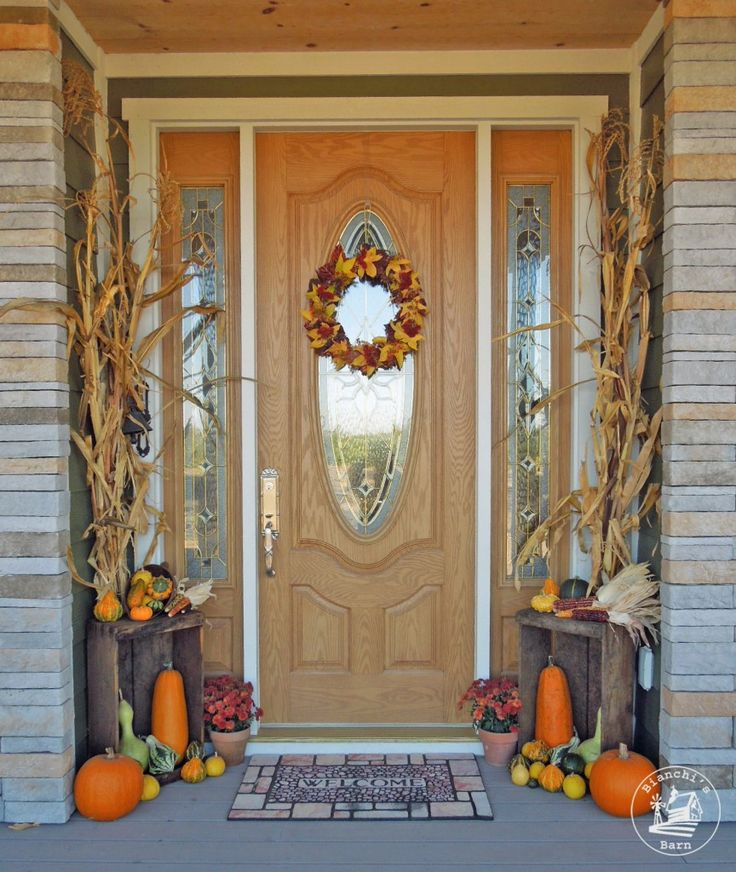 Cornstalks, pumpkins, ornamental gourds and corn with a couple of vintage wood boxes make a great fall entryway!