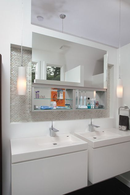 Midcentury Bathroom by Burns Century Interior Design--love the idea of keep the electric toothbrushes pludded in, inside the cabinet.  Don't like how the mirrored door goes up to open cabinet.  Too high for me to see!