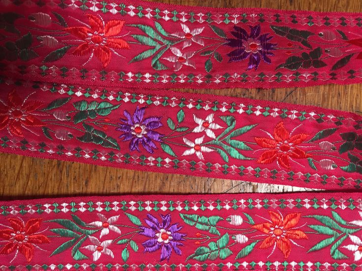 Beautiful red floral ribbon purple, green and red florals, red background, edging, 1 3/8 inches wide, French by PromenadeFabrics on Etsy https://www.etsy.com/listing/203881353/beautiful-red-floral-ribbon-purple-green