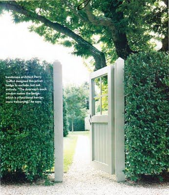 This gate mimics a front door with the windows and size. Surrounded by the privet hedge, there is no guessing where the entrance is located.  Image from House & Garden.