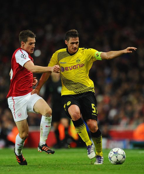 Aaron Ramsey of Arsenal closes down Sebastian Kehl of Dortmund during the UEFA Champions League Group F match between Arsenal FC and Borussia Dortmund  at Emirates Stadium on November 23, 2011 in London, England. - 14 of 60