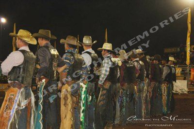 Cowboy line up at a Rodeo