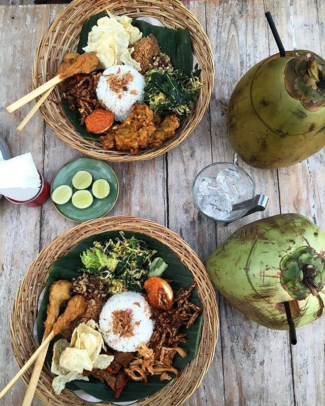 Nasi campur, literally mixed rice, is an Indonesian mish-mash of rice, skewers, veggies, fried things and sambal. And shredded things. And more. #bali #indonesia