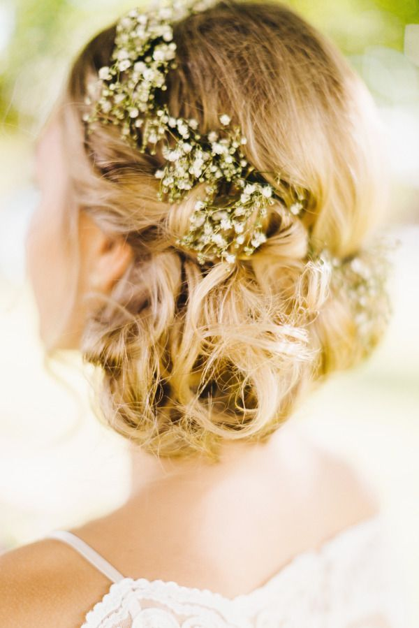 vinatge rustic wedding hairstyle-low bun updo with baby's breath