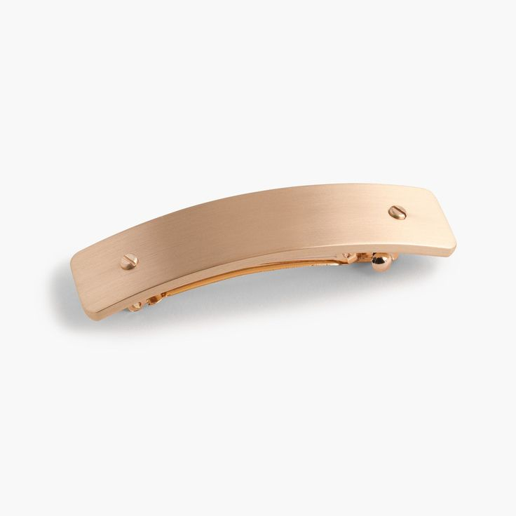 How to guarantee a good hair day? Add this minimal clip in a modern brushed metal. 3 3/8H x 3/4W. Steel. Import. Select stores.
