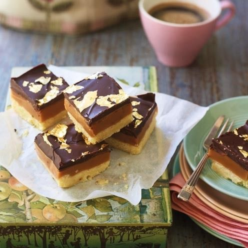 Billionaire's shortbread recipe topped with gold leaf. www.goodhousekeeping.co.uk