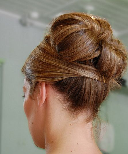 High up hairdo for wedding with rolls.PNG