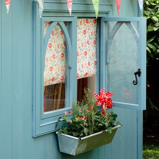 Decorate the exterior of your summerhouse in a fetching blue, and for a cottage-style effect, finish with a retro floral blind and a windowbox of miniature red roses and rosemary to scent the air.