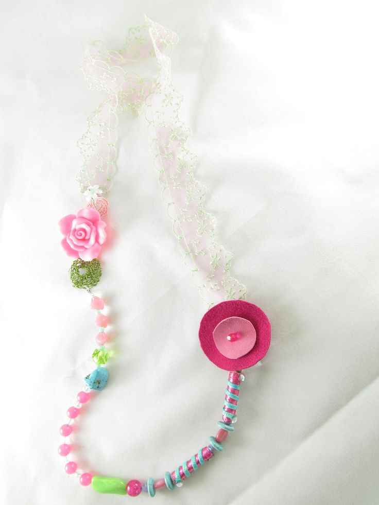 Handmade necklace with lace (1 pc)  Made with handmade beads with fiber and crystals, handmade wire motif, lace, leather, pink fimo flower, semiprecious stones and glass beads.