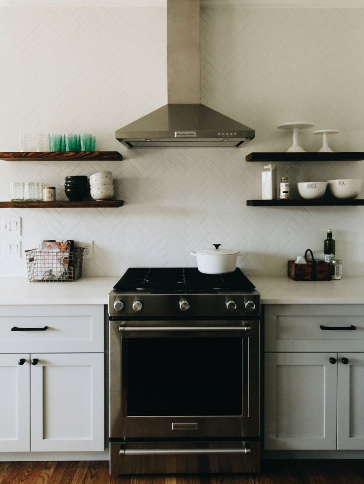 Floating Wood Shelves & Herringbone Pattern Subway Tile