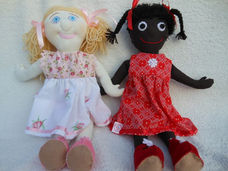 I used the same basic pattern for both dolls, but how different they look!  Ebony and Ivory!