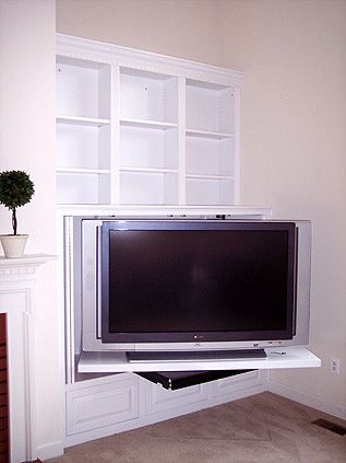 Corner Recessed Wall Media Center With Bifold Pocket Doors And A Tv Pull Out Swivel Easily